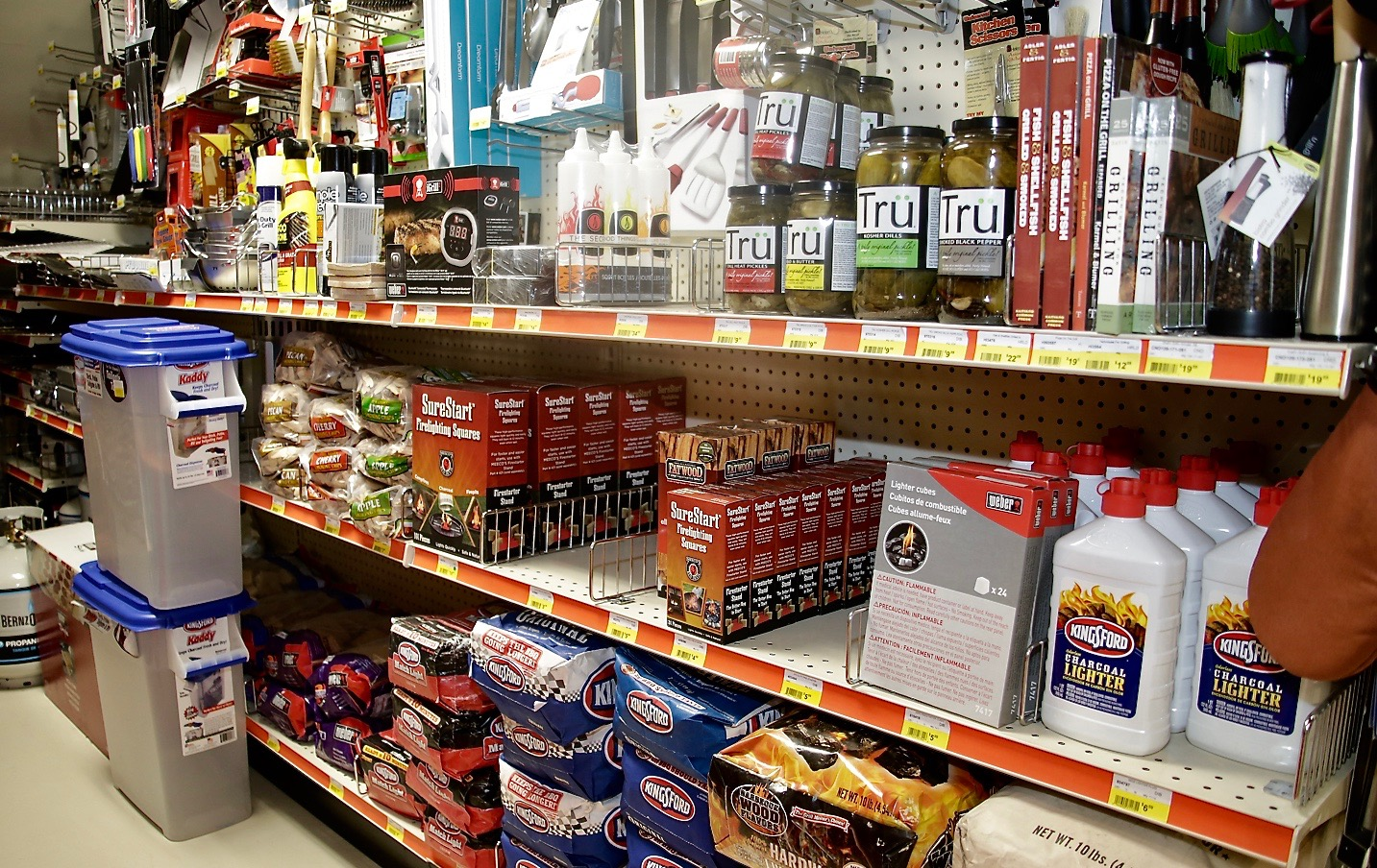 Woodstock Hardware aisle filled with everything needed for a BBQ, from charcoal to pickles and much more
