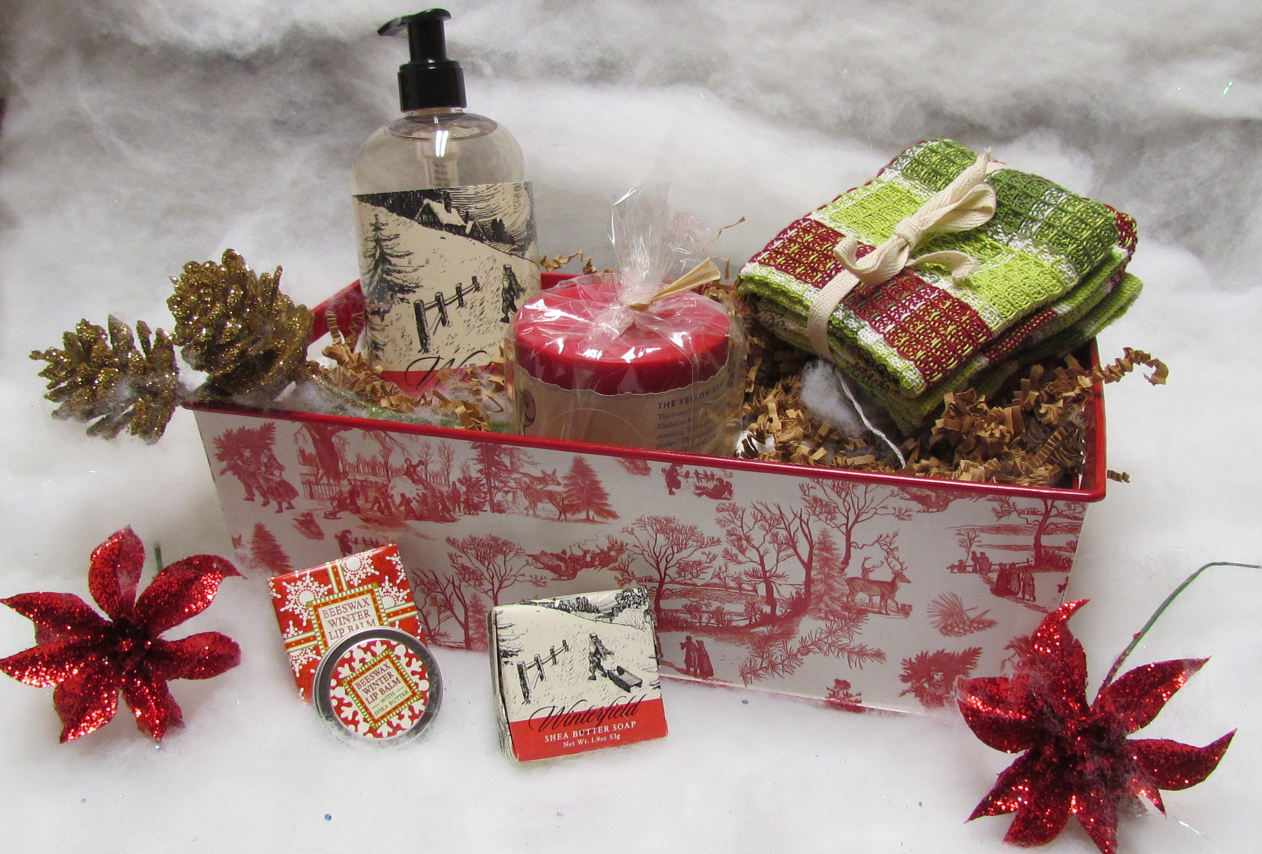 Beautifully gift-wrapped holiday boxes, in snow background