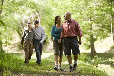 People walking on a forest path