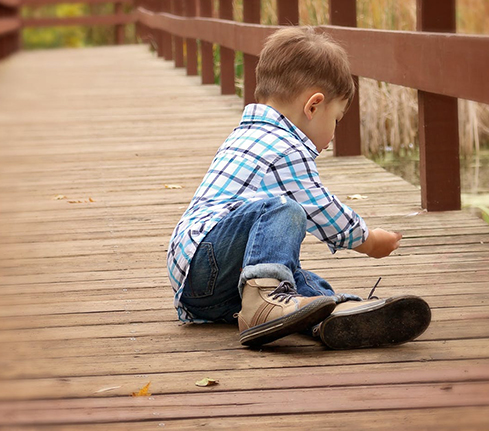 Child playing on a wooden deck