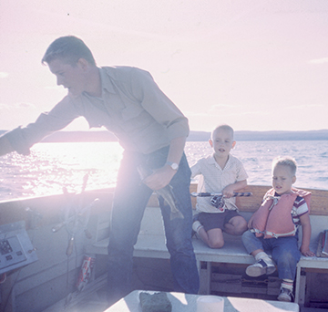 Fisherman with family in a boat