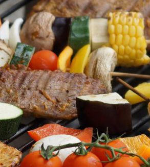 Vegetables and steak for outdoor BBQ on Weber grill