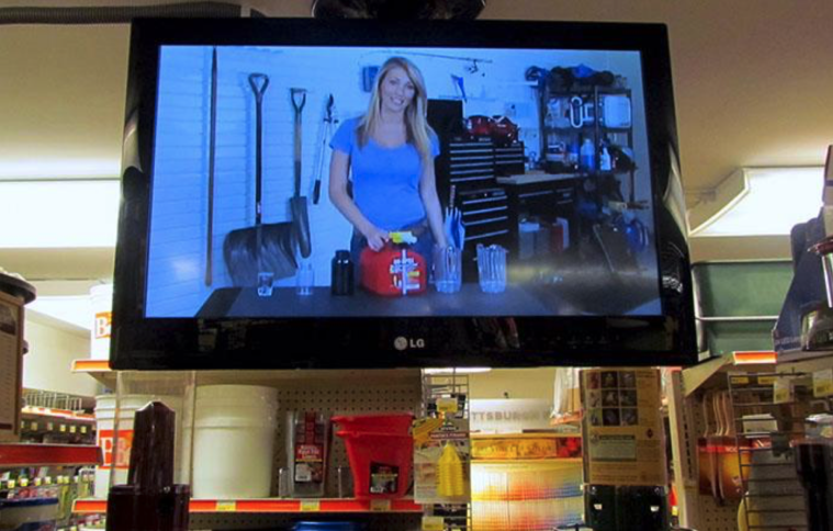 a TV mounted in a hardware store